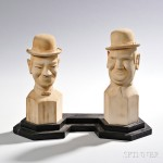 Carved Pine Laurel and Hardy Figures on Stand, 20th century (Lot 483, Estimate $100-$200)